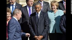 Russias President Vladimir Putin (2ndL) walks past US President Barack Obama (C), Brazils President Dilma Rousseff (L) and Germanys Chancellor Angela Merkel (R) as he arrives to pose for the family photo during the G20 summit on September 6, 2013 in Saint Petersburg.