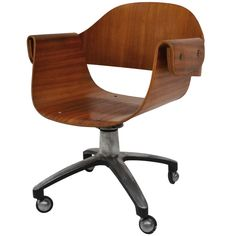 Chair for desk  in plywood- 50's | From a unique collection of antique and modern office chairs and desk chairs at http://www.1stdibs.com/furniture/seating/office-chairs-desk-chairs/