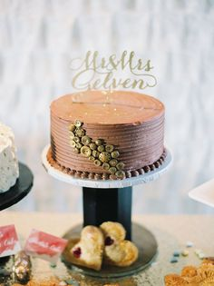wedding cake with buttons - photo by Untamed Heart Photography http://ruffledblog.com/pink-watercolor-country-club-wedding