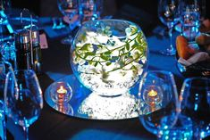 Table centrepiece - nice use of the orchid set in a fishbowl vase with LED lighting