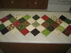 Christmas runner - i have some leftover charms from this collection!