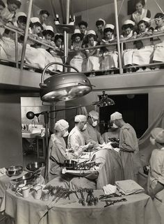 Student nurses in Multnomah County Hospital observe surgeons as they are performing surgery on a patient. Photo taken circa 1945