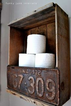 Rustic crate and license plate toilet paper holder by Funky Junk Interiors. Bet you could do something wonderful along these lines.License plate a little too rustic for me, but idea is good. Funky Junk Interiors, Outhouse Bathroom Decor, Bathroom Shelves, Bathroom Ideas, Bathroom Storage, Garage Bathroom, Guys Bathroom, Master Bathroom, Bathroom Wall