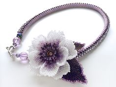 Beaded flower brooch and bead crochet necklace