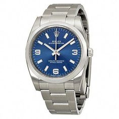 95f326fc95d Stainless steel case with a stainless steel Rolex oyster bracelet. Fixed  domed stainless steel bezel. Blue dial with silver-tone hands and index  hour ...