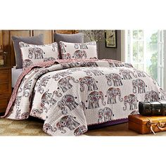 By The Seashore brings a casual coastal atmosphere to your home. This quilt set features a colorful elephant pattern. Bring the atmosphere of daring safari to your home. Includes a comforter and 2 pillow shams (1 for twin size).