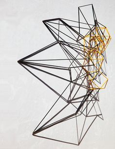 This geometric sculpture shows many ACTUAL LINES. It also shows a bit of RYTHYM through the REPETITION of these LINES.
