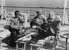 Hitler kicking back while Goebbels looks as thought Magda just arrived as he was about to jump start another affair. Cool your jets, Joe. This is 1935.