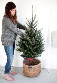 Put a bucket upside down in a large basket; small tree in small stand goes on top cover with fur/blanket or other fabric.