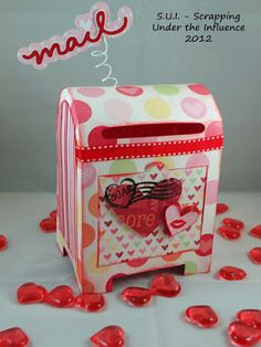 how cute! I have seen this done with a cereal box but any box would do!! Super cute school Valentine Box.