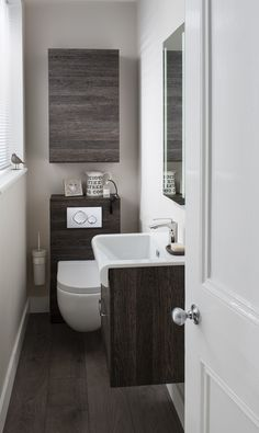 Cloakroom with Stream II Sanitaryware Collection. Choose from wall or floor mounted options with a fully glazed flushing rim and luxe touches such as soft close seats.   #cloakroom #small #space #bathroom #toilet