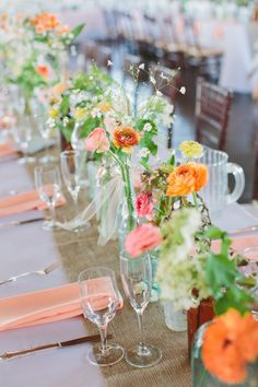 the brightest bright florals look stunning all lined up on these long tables  Photography by laurenfairphotography.com, Floral Design by liliesandlavender.com, Wedding Day Coordination by dpnak.com