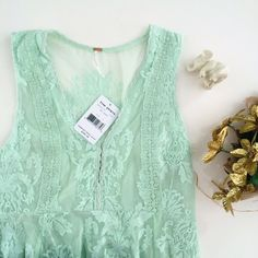 """Free People sea green lace dress NWT from Free People. Love this dress but it's too big for me! Size 6 and fits slightly on the large side. Underarm to underarm measures 16.5"""" laying flat. Total length is 31.5"""". Side zip. Two hook and eye closures at bust. Lace detail throughout. Color is sea green. Lined. Nylon, cotton, and rayon. Hand wash cold. From a pet free and smoke free home. Free People Dresses Mini"""