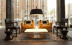 The black and gold color scheme of the Fitzwilliam Hotel in Belfast makes a powerful statement. Clean-lined seating and striking pillows also add elegant flair to the space: