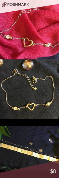 Gold and silver diamond heart anklet Very pretty gold and silver anklet. Has two diamonds on either side of a heart. Has another diamond at the clasp. It's about 10 inches long with over an inch of adjustable chain links. Very easy clasp. Jewelry Bracelets