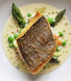 The firm flesh of bream in Nathan Outlaw's recipe is complemented by the sweet flavour of cream-enriched tartare-style sauce flecked with potatoes, asparagus, lettuce and peas. You can buy two large, whole fish if you want to fillet them yourself, or ask Fish Dishes, Seafood Dishes, Fish Recipes, Seafood Recipes, Sea Bream Recipes, Salmon Recipes, Recipes Dinner, Fish Supper, Great British Chefs