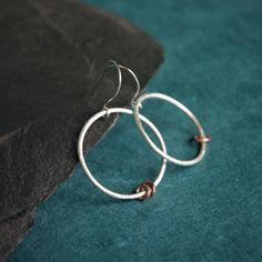 Sterling silver hoops of diameter just over an inch- a bit larger than a piece hang from sterling silver handmade ear hooks . The hoops are made with thick silver wire and have a frosted , matt surface finish and can move about , which highli. Copper Rings, Copper Jewelry, Gifts For Friends, Gifts For Her, Jewelry Shop, Jewellery, Sterling Silver Hoops, Beautiful Gifts, Handmade Silver