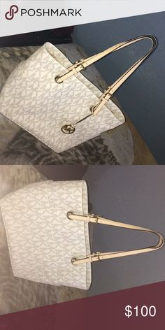 Michael Kors jet set signature tote In perfect condition. Have only worn it twice.  • Exterior Details: 2 Side Slit Pockets  • Interior Details: Back Compartment With Zip Pocket, 2 Back Slit Pockets, Front Compartment With 6 Front Slit Pockets, Center Zip Compartment  • Lining: 100% Polyester Michael Kors Bags Totes