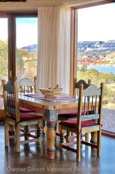 The bright, bold colors of this dining table and chairs plus the breathtaking views make dining very inviting. Vacation Rentals, Vacation Ideas, Dining Table Chairs, Dining Room, Abiquiu New Mexico, Bold Colors, Bright, Awesome, Places