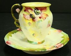 1298: LIMOGES FLORAL CUP AND SAUCER : Lot 1298