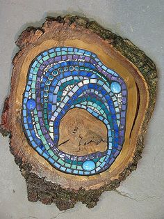 stepping stones - mosaic - wood & glass. Have the discs, just need to figure out how to make this work!