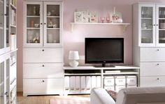 Lamp and shelf. Tv between units. BORGSJÖ white TV storage combination with drawers and glass doors