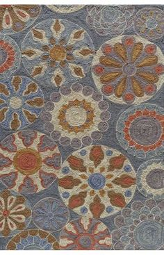 This in area rug, but I pinned it as color scheme inspiration. Blue, gold, coral, and gray or purple