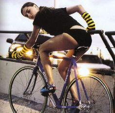 Velorution - Girl on fixie w striped wrist bands