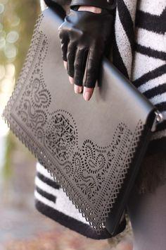 Black leather clutch handbag