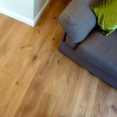 Natural oak floor in Living room. Grey sofa and natural oak floor.