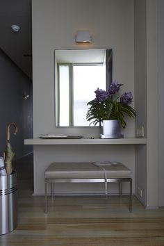 Shelf as entry table with bench. My mudroom would not be this sleek. I just like the use of space.