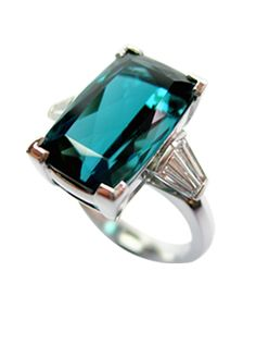 Indicolite tourmaline and diamond engagement ring, Rare 14 carat cushion cut  indicolite with tapered baguette diamond shoulders.