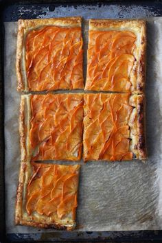This Persimmon Tart from HonestlyYUM features tart persimmons over buttery puff pastry. It uses frozen pastry, so this dessert is super quick and easy to put together! Quick Apple Dessert, Apple Desserts, Delicious Desserts, Winter Desserts, Vegan Desserts, Tart Recipes, Baking Recipes, Dessert Recipes, French Apple Tart