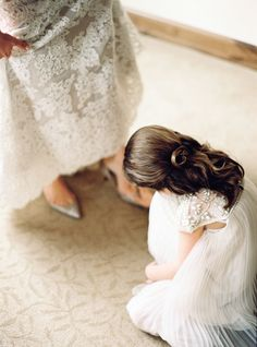 Flower Girl helping Mommy into her wedding shoes