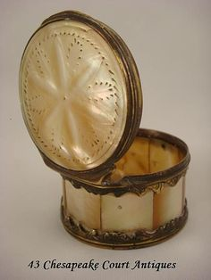 Mother of pearl and gilt snuff box