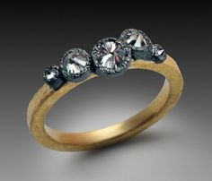 Todd Pownell - Ring with five inverted diamonds set in 14k ruthenium plated white gold with 18k yellow gold textured band.