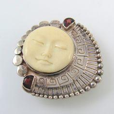 Sajen carved bone, garnet and sterling brooch, unsure of artist, does not link back.