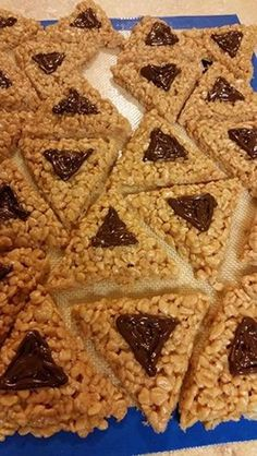 Rice Crispie Treat Hamantaschen! There are SO many different ideas for hamantaschen. This one looks good!