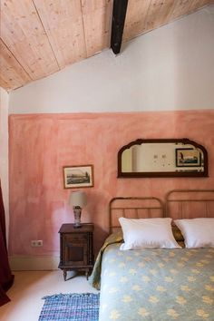 Leave it to this dreamy lodge in Portugal to inspire some serious room envy and make a case for painting our bedroom walls in a saturated pink. The room's old-world flair is reminiscent of a Van Gogh, while the unlikely color block between the coral and white alludes to a design detail that's both modern and fresh.