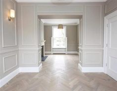 Love the floor and lower half picture moulding. Would paint lower half white and the upper half that grey, but without the moulding. Home Room Design, Home Interior Design, Interior Architecture, Living Room Designs, House Design, New Living Room, Living Room Decor, Dining Room Wainscoting, Wainscoting Styles