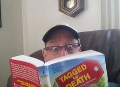 Reggie reading Tagged for Death