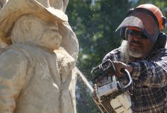 Tim Amos sculpts trees with chainsaws. Read about his hobby in the link! #sculpting #SouthDakota #RapidCity