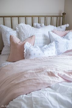 Dogwood blush pink duvet cover blend so well with the white bedding.