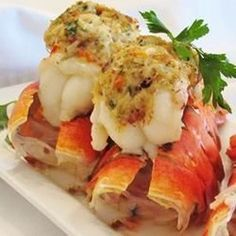 "Crab-Stuffed Lobster Tail Recipe - - ""Lobster tail with a New England-style cracker and crabmeat stuffing. Serve with fresh lemon wedges and homemade dinner rolls for an exquisite but surprisingly simple meal. Seafood Seasoning, Seafood Soup, Seafood Dishes, Fish And Seafood, Fresh Seafood, Lobster Recipes, Fish Recipes, Seafood Recipes, Cooking Recipes"
