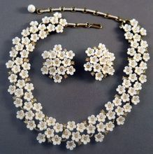 Coro White Flowers Necklace Earrings Set 1955 Ad Book Piece from Suzy's Timeless Treasures on Ruby Lane