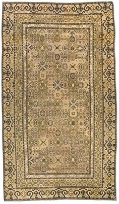 A Samarkand rug BB4386 - An early 20th century Samarkand (Khotan) rug, the sand field with a subtle geometric trellis with racemes and flowe ...