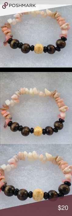 """Pink Opal and Wood Bracelet This pretty bracelet is made with natural pink Opal chips and black Agate accents. It also features several wooden beads.   This piece is on elastic and will stretch to fit up to a 7"""" wrist.   All PeaceFrog jewelry items are handmade by me! Take a look through my boutique for more unique creations. PeaceFrog Jewelry Bracelets"""