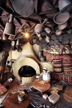"""Turkish woman making """"Gozleme"""". One of the Turkish traditional pastry dish.."""