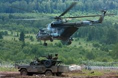 Military Vehicle Photos - Land Rover & Helicopter