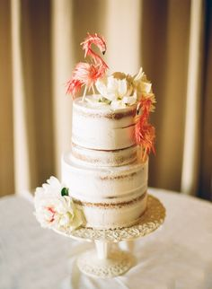 Naked Wedding Cake with Flamingo Cake Toppers | Natalie Watson Photography on @bajanwed via @aislesociety